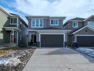 Photo 1: 55 SUNSET Parkway: Cochrane House for sale : MLS®# C3651244