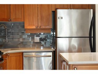 "Photo 14: 404 1432 PARKWAY Boulevard in Coquitlam: Westwood Plateau Condo for sale in ""Ironwood- Montreux"" : MLS®# V1135534"