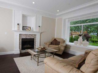 Photo 2: 1822 ISLAND AV in Vancouver: Fraserview VE House for sale (Vancouver East)  : MLS®# V1009385