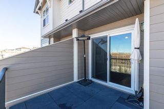 Photo 35: 603 101 SUNSET Drive: Cochrane Row/Townhouse for sale : MLS®# A1031509