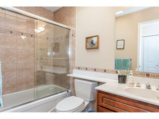 """Photo 17: 9769 148A Street in Surrey: Guildford Townhouse for sale in """"Chelsea Gate"""" (North Surrey)  : MLS®# R2394189"""