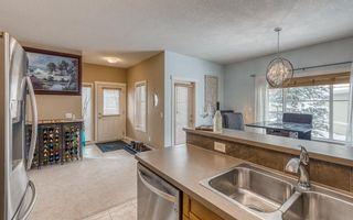 Photo 5: 1401 281 COUGAR RIDGE Drive SW in Calgary: Cougar Ridge Row/Townhouse for sale : MLS®# A1070231