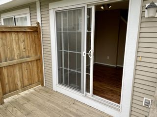Photo 3: 32 Country Village Lane NE in Calgary: Country Hills Village Row/Townhouse for sale : MLS®# A1115635