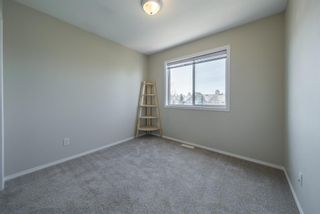 Photo 22: 404 720 Willowbrook Road NW: Airdrie Row/Townhouse for sale : MLS®# A1098346