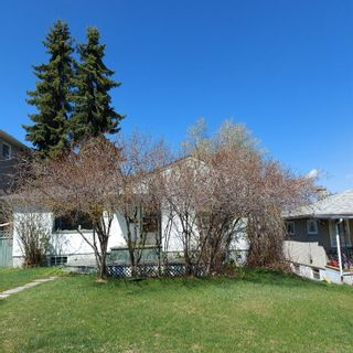 Photo 1: 208 25 Avenue NW in Calgary: Tuxedo Park Detached for sale : MLS®# A1109100