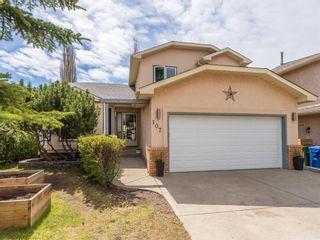 Photo 1: 107 Hawktree Bay NW in Calgary: Hawkwood Detached for sale : MLS®# A1113635