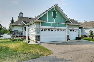 Photo 1: 20 1008 Woodside Way NW: Airdrie Row/Townhouse for sale : MLS®# A1133633