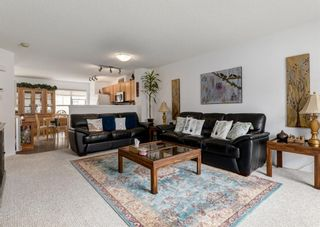 Photo 3: 311 Toscana Gardens NW in Calgary: Tuscany Row/Townhouse for sale : MLS®# A1118245