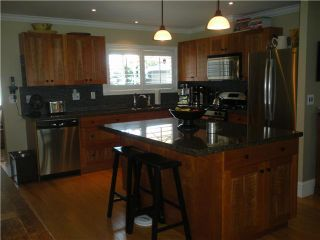 Photo 3: 1345 COTTONWOOD CR in North Vancouver: Norgate House for sale : MLS®# V1008223