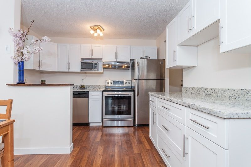 """Main Photo: 209 1551 W 11TH Avenue in Vancouver: Fairview VW Condo for sale in """"LABURNUM HEIGHTS"""" (Vancouver West)  : MLS®# R2047000"""