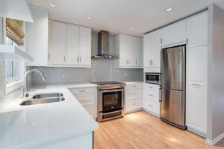 Photo 3: 1407 1 Street NE in Calgary: Crescent Heights Row/Townhouse for sale : MLS®# A1121721