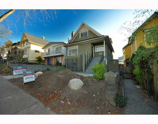 "Main Photo: 2056 E 3RD Avenue in Vancouver: Grandview VE House for sale in ""COMMERCIAL DRIVE"" (Vancouver East)  : MLS®# V799384"