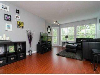"Photo 1: 306 13955 LAUREL Drive in Surrey: Whalley Condo for sale in ""King George Manor"" (North Surrey)  : MLS®# F1422103"