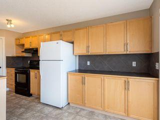 Photo 8: 133 Saddlebrook Way NE in Calgary: Saddle Ridge Detached for sale : MLS®# A1041783
