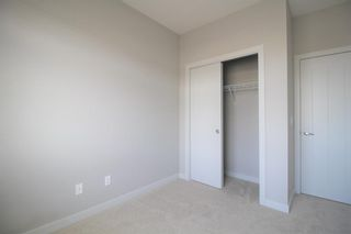Photo 23: 296 Silverado Plains Park SW in Calgary: Silverado Row/Townhouse for sale : MLS®# A1065666