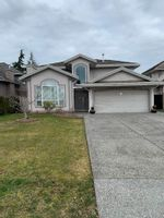 Main Photo: 13021 74 Avenue in Surrey: West Newton House for sale : MLS®# R2545509