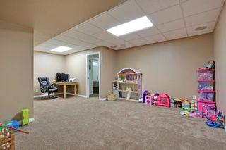 Photo 24: 145 Cranston Way SE in Calgary: House for sale : MLS®# C3640980