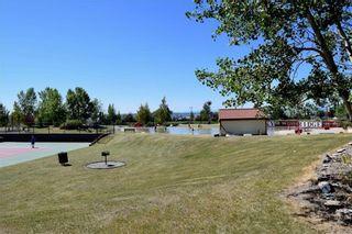 Photo 31: 105 Rocky Ridge Court NW in Calgary: Rocky Ridge Row/Townhouse for sale : MLS®# A1069587