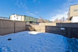 Photo 2: 99 3809 45 Street SW in Calgary: Glenbrook Row/Townhouse for sale : MLS®# A1066795