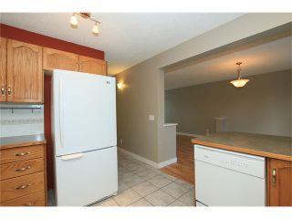 Photo 19: 74 WEST TERRACE Road: Cochrane House for sale : MLS®# C4073559