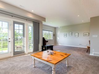 Photo 25: 46 RIVIERA Way: Cochrane Row/Townhouse for sale : MLS®# C4281559