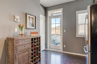 Photo 7: 440 Ascot Circle SW in Calgary: Aspen Woods Row/Townhouse for sale : MLS®# A1090678