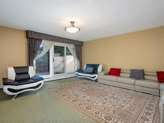 Photo 3: 616 3130 66 Avenue SW in Calgary: Lakeview Row/Townhouse for sale : MLS®# A1106469