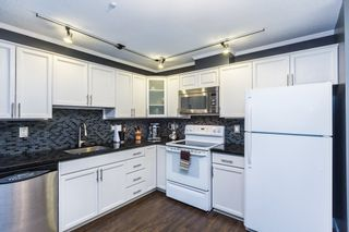 """Photo 5: 411 68 RICHMOND Street in New Westminster: Fraserview NW Condo for sale in """"GATEHOUSE"""" : MLS®# R2150435"""