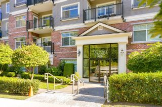 """Photo 2: 101 19530 65 Avenue in Surrey: Clayton Condo for sale in """"WILLOW GRAND"""" (Cloverdale)  : MLS®# R2620784"""
