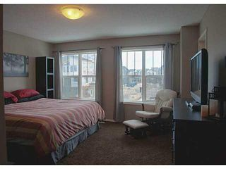 Photo 10: 418 WALDEN Drive SE in Calgary: Walden House for sale : MLS®# C3649474