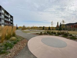Photo 3: 205 8530 8A Avenue SW in Calgary: West Springs Apartment for sale : MLS®# A1080205