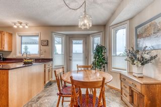 Photo 10: 210 Arbour Cliff Close NW in Calgary: Arbour Lake Semi Detached for sale : MLS®# A1086025