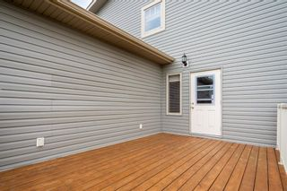 Photo 31: 2 Mackenzie Way: Carstairs Detached for sale : MLS®# A1132226