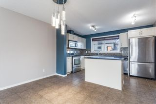 Photo 2: 204 WALDEN Drive SE in Calgary: Walden Row/Townhouse for sale : MLS®# C4274227