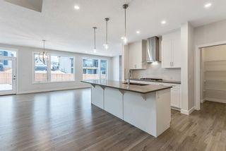 Photo 3: 294 Crestmont Drive SW in Calgary: Crestmont Detached for sale : MLS®# A1055191