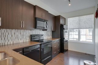 Photo 11: 111 Ascot Point SW in Calgary: Aspen Woods Row/Townhouse for sale : MLS®# A1144877