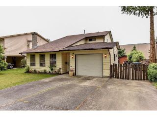"""Photo 1: 14526 85A Avenue in Surrey: Bear Creek Green Timbers House for sale in """"GREEN TIMBERS"""" : MLS®# F1442666"""