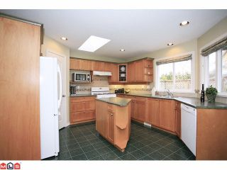 """Photo 5: 18127 68TH Avenue in Surrey: Cloverdale BC House for sale in """"Cloverwoods"""" (Cloverdale)  : MLS®# F1111652"""