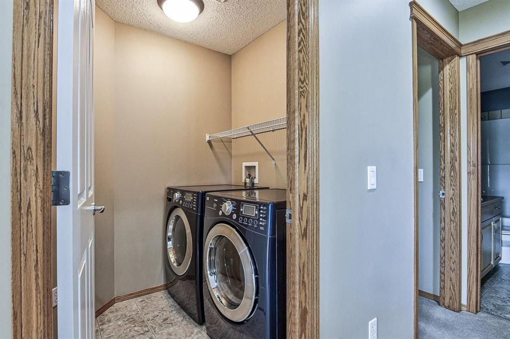Photo 28: Photos: 106 Everwillow Close SW in Calgary: Evergreen Detached for sale : MLS®# A1116249