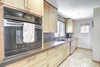 Photo 8: 5604 Buckthorn Road NW in Calgary: Thorncliffe Detached for sale : MLS®# A1119366