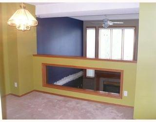 Photo 4: 140 INGLEWOOD Cove SE in Calgary: Inglewood Townhouse for sale : MLS®# C3392382