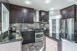 Photo 1: 87 Panatella Drive NW in Calgary: Panorama Hills Detached for sale : MLS®# A1107129