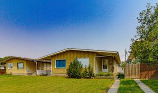 Main Photo: 2016 42 Street SE in Calgary: Forest Lawn Duplex for sale : MLS®# A1129097