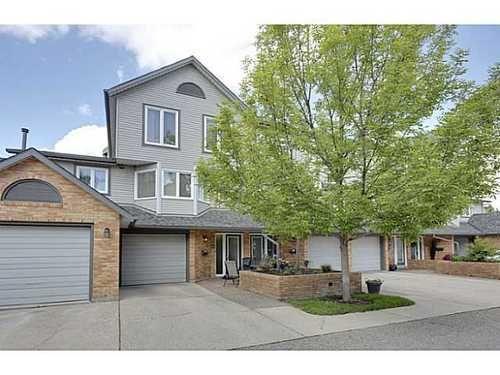 Main Photo: 22 COACHWAY Green SW in Calgary: 4 Level Split for sale : MLS®# C3572923