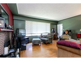 Photo 4: 714 IVY Avenue in Coquitlam: Coquitlam West House for sale : MLS®# V1131997