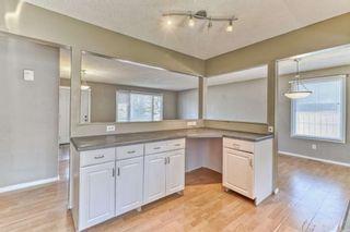 Photo 11: 316 Queen Alexandra Road SE in Calgary: Queensland Detached for sale : MLS®# A1104461
