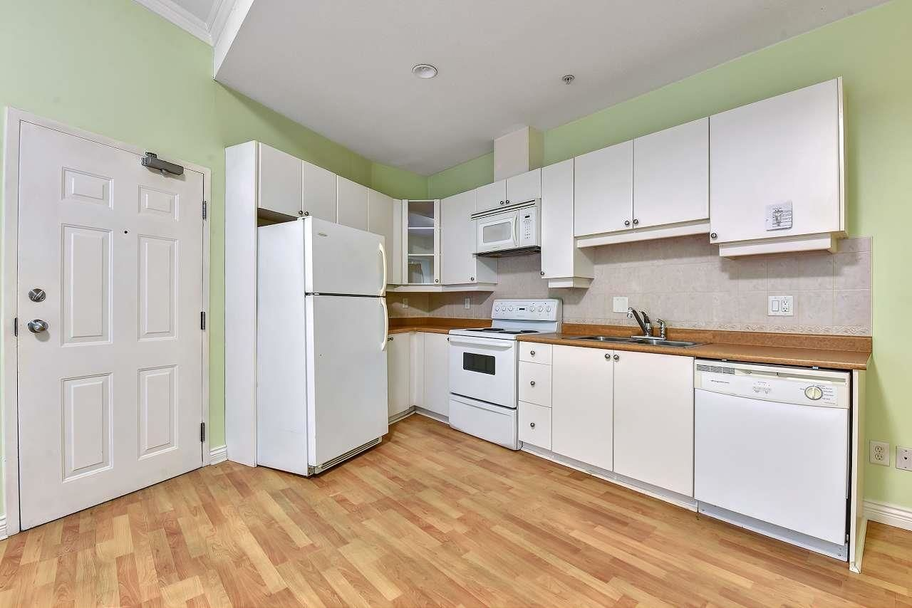Photo 2: Photos: 2114 TRIUMPH Street in Vancouver: Hastings Condo for sale (Vancouver East)  : MLS®# R2601886