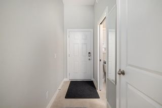 Photo 4: 205 Jumping Pound Common: Cochrane Row/Townhouse for sale : MLS®# A1138561