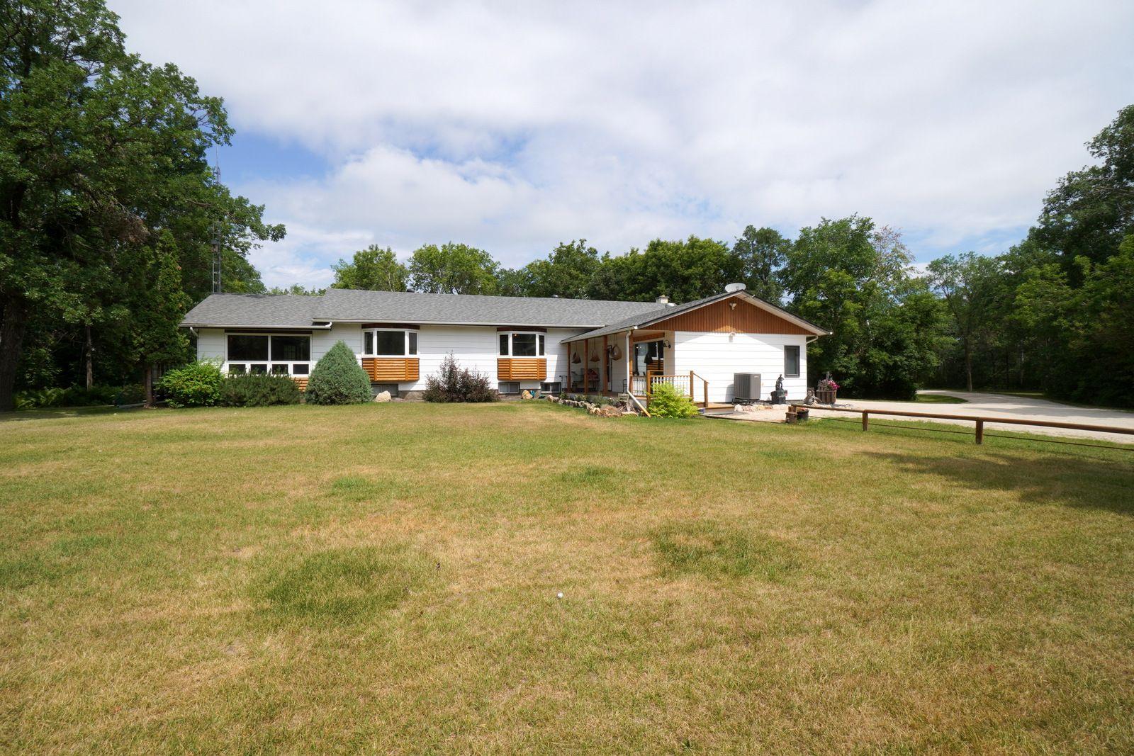 Main Photo: 39066 Road 64 N in Portage la Prairie RM: House for sale : MLS®# 202116718