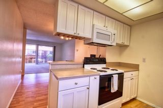 Photo 2: MISSION VALLEY Condo for sale : 2 bedrooms : 6069 Rancho Mission Road #202 in San Diego